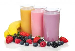 plant-based smoothie milk beverages - strawberry, blueberry and banana