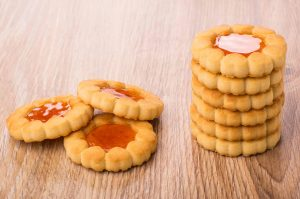 orange citrus filled jam cookies stacked food